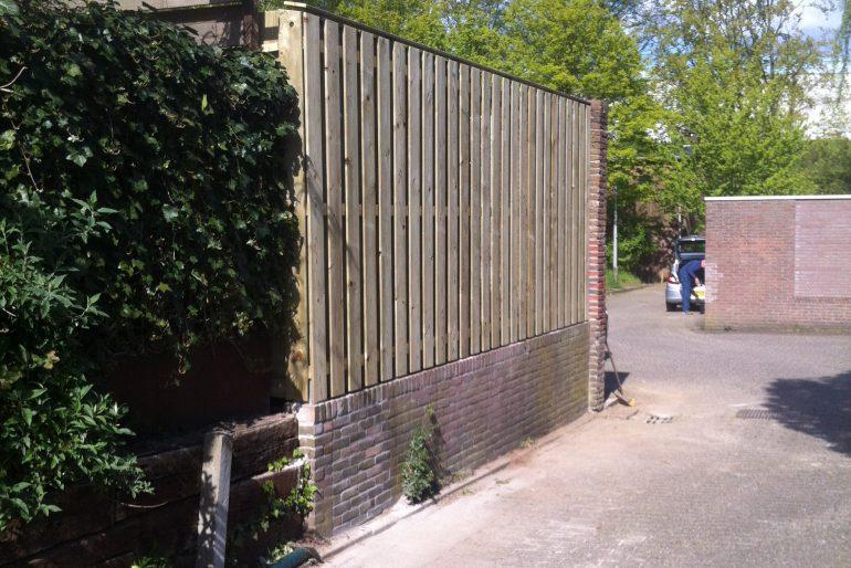 Herstel muur en plaatsen schutting
